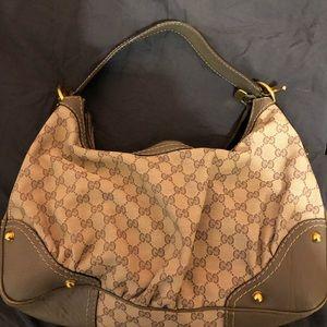 Gucci logo handbag.